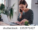 woman talking on the phone and... | Shutterstock . vector #1352971427