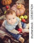young cute little boy sitting...   Shutterstock . vector #135307424