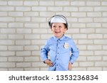 portrait 4 year old boy plays... | Shutterstock . vector #1353236834