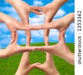 Female hands showing medical cross symbol concept on summer landscape background - stock photo