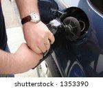 pumping gas into car | Shutterstock . vector #1353390