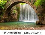 Stunning spring landscape.Paleokarya, old, stone, arched bridge, between two waterfalls. Trikala prefecture, Thessaly, Greece