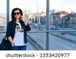 smiling woman ot glass bridge...   Shutterstock . vector #1353420977