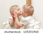 Cute Baby Kissing A Mirror Wit...