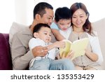 asian family sharing a book | Shutterstock . vector #135353429