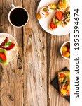 breakfast table with tasty... | Shutterstock . vector #1353594674