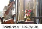 young pretty woman drinking... | Shutterstock . vector #1353751001
