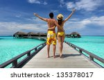 couple on a tropical beach... | Shutterstock . vector #135378017