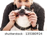 Stock photo woman with her dog playing 135380924