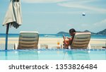 beautiful young woman using her ... | Shutterstock . vector #1353826484