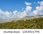clouds over the mountain range. ... | Shutterstock . vector #1353921794