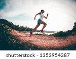 woman trail runner running on... | Shutterstock . vector #1353954287