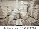 sacks of flour in the bakery... | Shutterstock . vector #1353974714