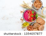 smoothie bowl with granola ... | Shutterstock . vector #1354057877
