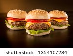 Three Mini Burgers In A Dark...