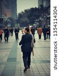 Small photo of CHONGQING, CHINA – MARCH 13: Porter or BangBang in street looking for business on March 13, 2018 in Chongqing. With 17M population, it is the most populous Chinese municipality.