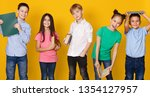 school children with books... | Shutterstock . vector #1354127957