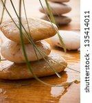 massage stones with green... | Shutterstock . vector #135414011