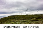 wind farm with a lot of... | Shutterstock . vector #1354141931