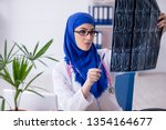 arab female doctor working in... | Shutterstock . vector #1354164677