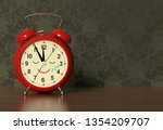 funny alarm clock sleeps on a... | Shutterstock . vector #1354209707