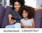 happy afro mother or elder... | Shutterstock . vector #1354297547