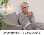 cozy lifestyle  mature woman...   Shutterstock . vector #1354300541