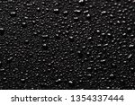small grey drops on glass close ... | Shutterstock . vector #1354337444