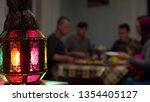 muslim family eating dinner at... | Shutterstock . vector #1354405127