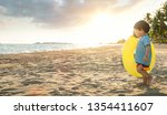 asian boy play  on the beach ... | Shutterstock . vector #1354411607