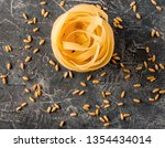 fettuccine from durum wheat and ... | Shutterstock . vector #1354434014