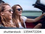 two girlfriends in a... | Shutterstock . vector #1354472204