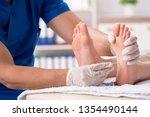 podiatrist treating feet during ... | Shutterstock . vector #1354490144