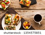 breakfast table with tasty... | Shutterstock . vector #1354575851