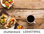 breakfast table with tasty... | Shutterstock . vector #1354575941