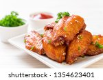 baked barbecue chicken wings...   Shutterstock . vector #1354623401