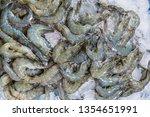fresh shrimps on the ice on... | Shutterstock . vector #1354651991