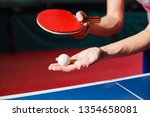 a young man is playing ping...   Shutterstock . vector #1354658081