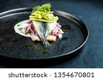 Stock photo herring elegant plate restaurant gourmet onion sauce plate exclusive food fish fillet elegant black 1354670801