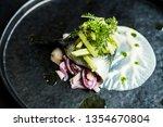 Stock photo herring elegant plate restaurant gourmet onion sauce plate exclusive food fish fillet elegant black 1354670804