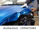 car wrapping specialist putting ... | Shutterstock . vector #1354672484