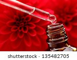 perfume and red dahlia flower