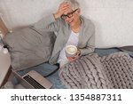 cozy lifestyle  mature woman...   Shutterstock . vector #1354887311