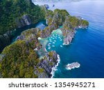 Small photo of El Nido, Philippines big lagoon , small lagoon from drone in Palawan. Hidden paradise. Blue Lagoon.