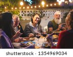 happy family eating and... | Shutterstock . vector #1354969034