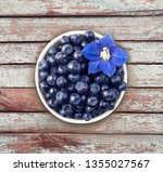 top view. bilberres and blue... | Shutterstock . vector #1355027567
