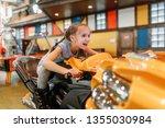 girl plays game machine ... | Shutterstock . vector #1355030984