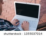 a young man working on a laptop ... | Shutterstock . vector #1355037014