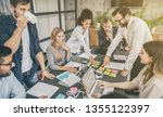 young business people meeting... | Shutterstock . vector #1355122397