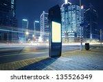 road car light trails through... | Shutterstock . vector #135526349